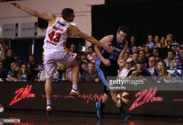 Christopher Goulding of the Tigers fouls against Dillon Boucher of the Breakers during the round 23 NBL match between the New Zealand Breakers and...