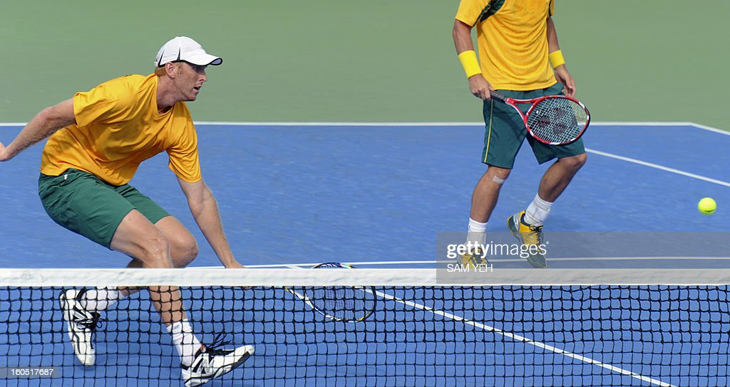 Christopher Guccione (L) and Lleyton Hewitt of Australia return a shot aginist Taiwan's Lee Hsin-han and Peng Hsien-yin during the Asia/Oceania Zone group 1 Davis Cup tennis match in Kaohsiung city in southern Taiwan on February 2, 2013. Australia 7-6, 6-4, 6-2. AFP PHOTO / Sam Yeh