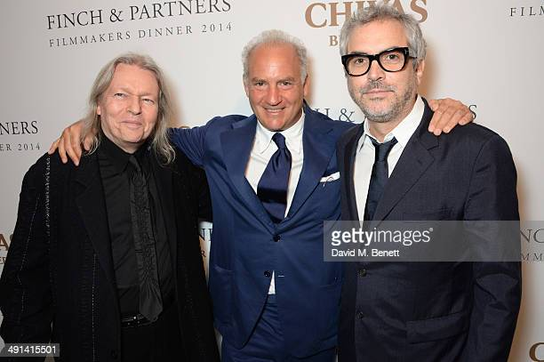 Christopher Hampton Charles Finch and Alfonso Cuaron attend the annual Charles Finch Filmmakers Dinner during the 67th Cannes Film Festival at Hotel...