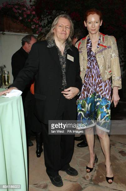 Christopher Hampton nominated for Adapted Screenplay and Tilda Swinton nominated for Best Supporting Actress are seen at a champagne reception to...