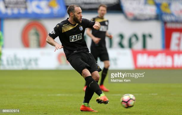Christopher Handke of Magdeburg runs with the ball during the third league match between FC Hansa Rostock and 1FC Magdeburg at Ostseestadion on April...