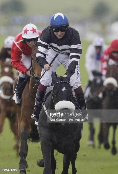 Christopher Hayes crosses the line on Wrong Answer to win the T P Waters Ebf Marble Hill Stakes during the Boylesportscom Irish 2000 Guineas Day at...