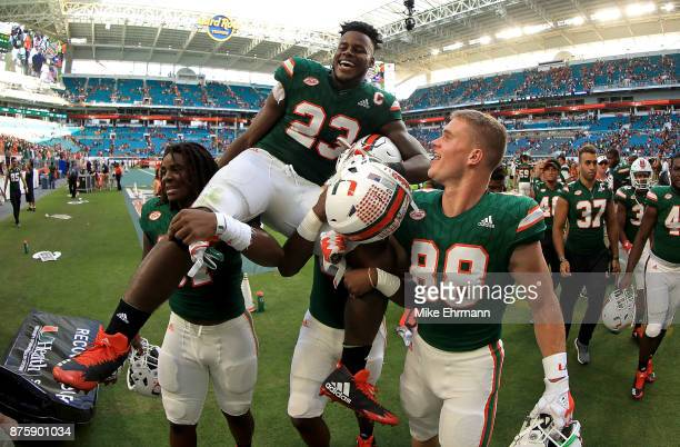 Christopher Herndon IV of the Miami Hurricanes is carried off the field after winning a game against the Virginia Cavaliers at Hard Rock Stadium on...