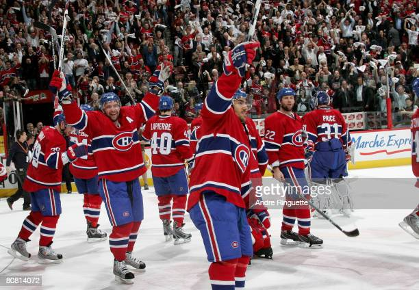 Christopher Higgins and Francis Bouillon of the Montreal Canadiens salute the crowd after their series win against the Boston Bruins during game...