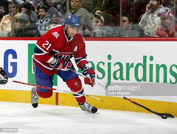 Christopher Higgins of the Montreal Canadiens stickhandles the puck against the Anaheim Ducks in his first game of teh 20082009 season at the Bell...