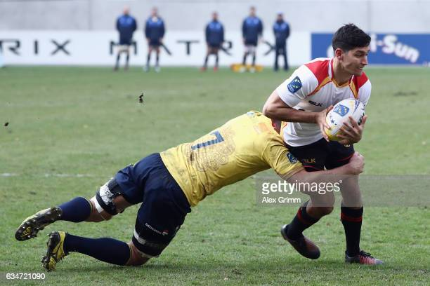 Christopher Hilsenbeck of Germany is challenged by Vlad Nistor of Romania during the European Shield Rugby match between Germany and Romania at...