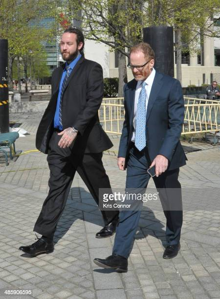 Christopher Hollosy and Bernard Grimm leave the H Carl Moultrie 1 Courthouse on April 21 2014 in Washington DC Singer Chris Brown's bodyguard...