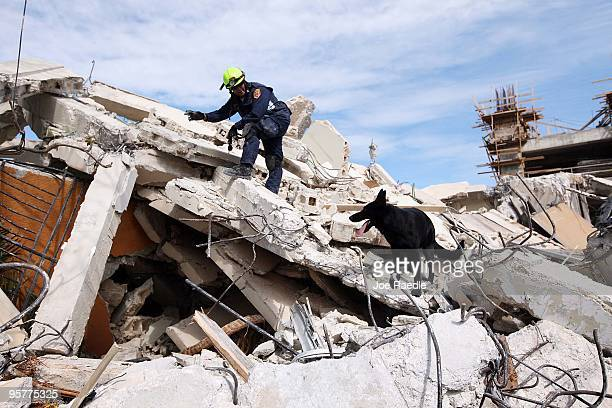 Christopher Holmes from the Fairfax County Urban Search and Rescue searches for survivors in the rubble of a building after a massive earthquake on...