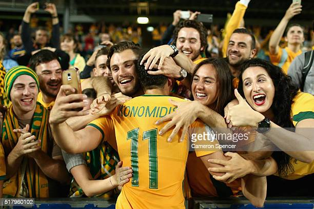 Christopher Ikonomidis of Australia celebrates with fans after winning the 2018 FIFA World Cup Qualification match between the Australian Socceroos...
