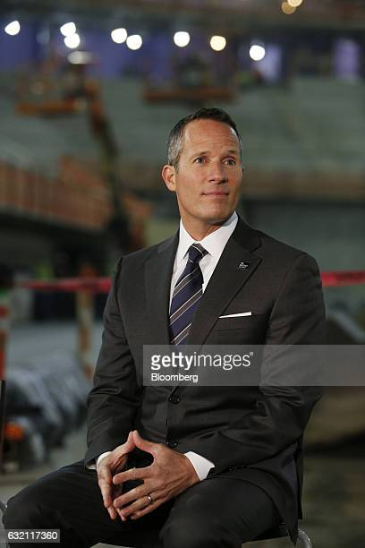 Christopher Ilitch president and chief executive officer for Ilitch Holdings Inc sits before a press conference at the Little Caesars Arena in...