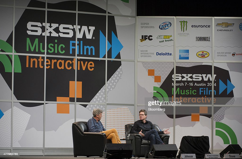 Christopher Isaac 'Biz' Stone, chief executive officer of Jelly Industries Inc. and co-founder of Twitter Inc., right, speaks as Steven Johnson, a writer and broadcaster, listens during a featured session at the South By Southwest (SXSW) Interactive Festival in Austin, Texas, U.S., on Tuesday, March 11, 2014. The SXSW conferences and festivals converge original music, independent films, and emerging technologies while fostering creative and professional growth. Photographer: David Paul Morris/Bloomberg via Getty Images