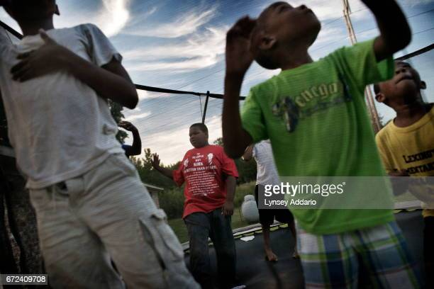 Christopher Jackson watches his friends jump on a trampoline in Holmes County at the edge of the Mississippi Delta May 31 2012 Christopher like his...