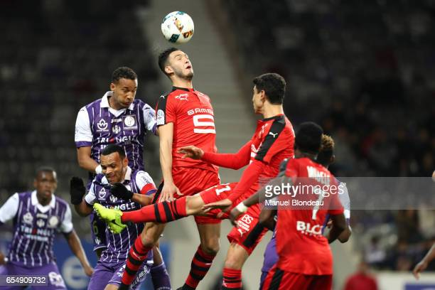 Christopher Jullien of Toulouse and Rami Bensebaini of Rennes during the French League match between Toulouse and Rennes at Stadium Municipal on...