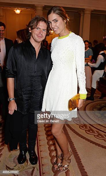 Christopher Kane and Amber Le Bon attend as Ambassador Barzun Mrs Brooke Barzun and Alexandra Shulman celebrate London Fashion Week at Winfield House...