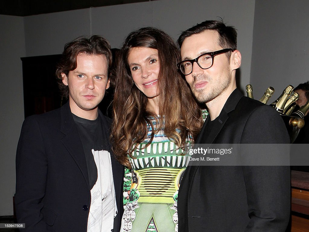 Christopher Kane, founder of the Emdash Foundation Andrea Dibelius and Erdem Moralioglu attend a private dinner hosted by Matthew Slotover and Amanda Sharp to celebrate the Frieze Projects and the Emdash Awards 2012 at Central St. Martin's on October 11, 2012 in London, England.