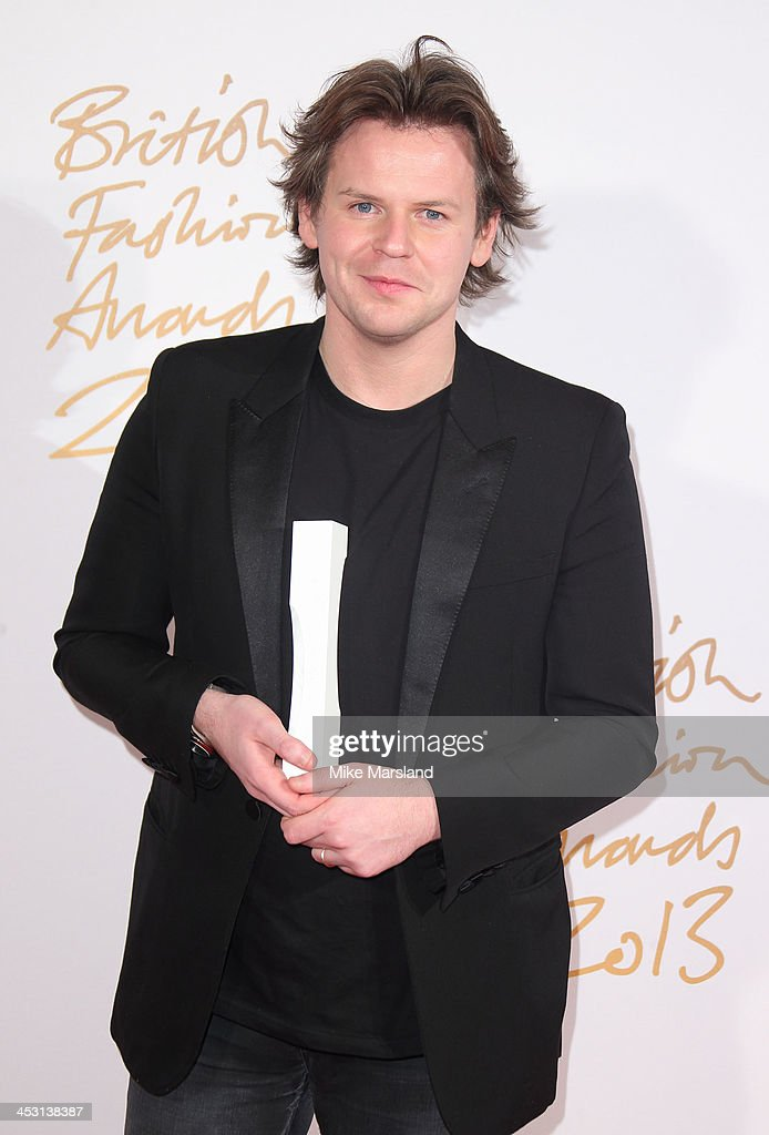Christopher Kane poses in the winners room at the British Fashion Awards 2013 at London Coliseum on December 2, 2013 in London, England.
