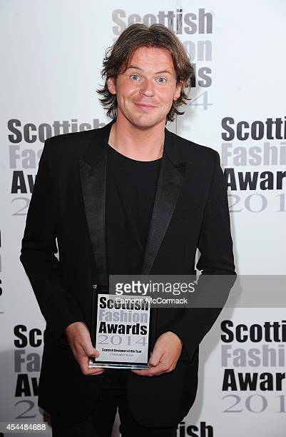 Christopher Kane poses in the Winners room at The Scottish Fashion Awards on September 1 2014 in London England