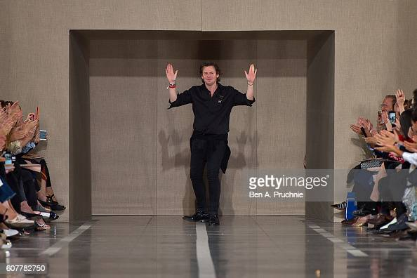 Christopher Kane waves to the audience at the end of the Christopher Kane runway show during London Fashion Week Spring/Summer collections 2017 on...