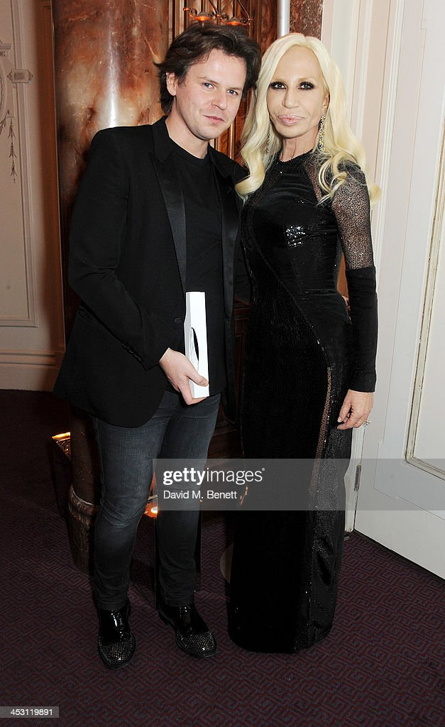 Christopher Kane (L), winner of Womenswear Designer of the Year, poses with Donatella Versace at the British Fashion Awards 2013 at London Coliseum on December 2, 2013 in London, England.