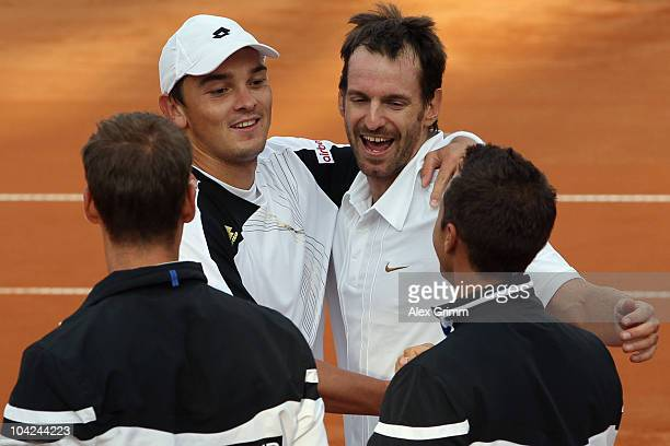 Christopher Kas and Andreas Beck of Germany celebrate with team mates Florian Mayer and Philipp Kohlschreiber after defeating Rik de Voest and Wesley...