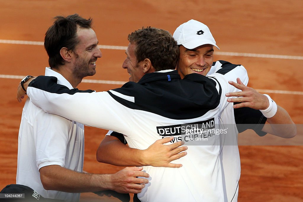 Christopher Kas (L) and Andreas Beck (R) of Germany celebrate with team captain Patrik Kuehnen (C) after defeating Rik de Voest and Wesley Moodie of South Africa during their double match at the Davis Cup World Group Play-Off tie between Germany and South Africa at Tenniclub Weissenhof on September 18, 2010 in Stuttgart, Germany.