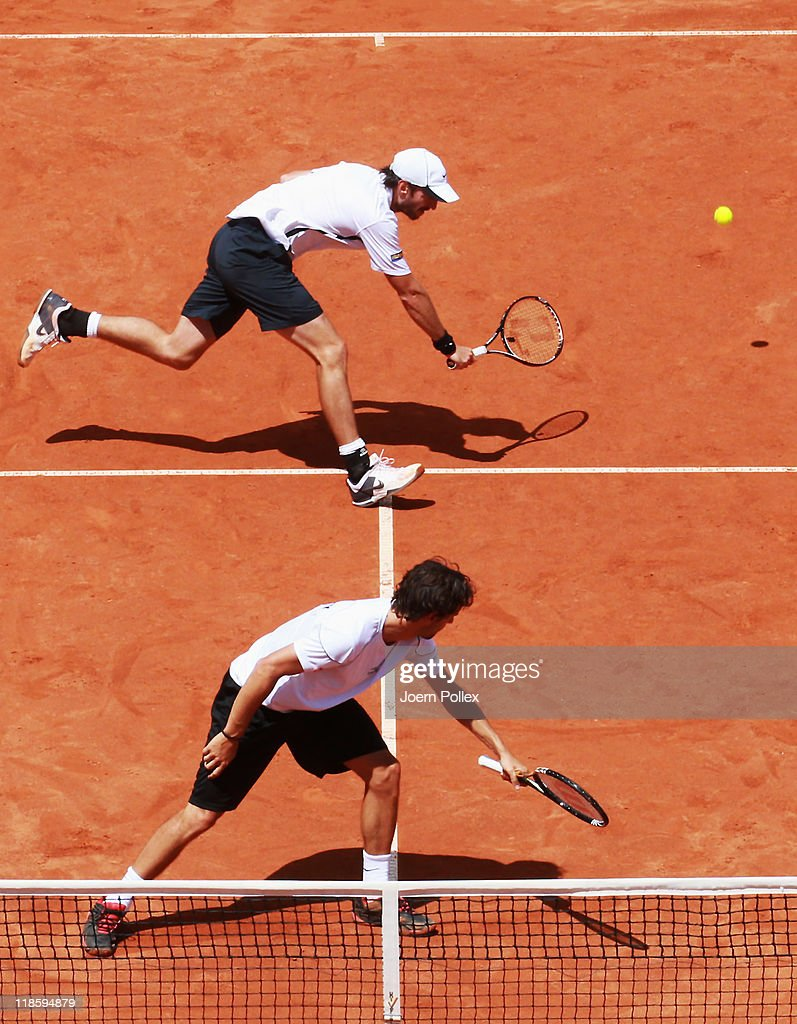 Christopher Kas and Philipp Petzschner of Germany in action during their doubles match against Michael Llodra and JoWilfried Tsonga of France during...