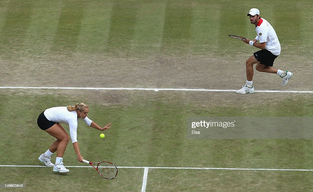 Christopher Kas and Sabine Lisicki of Germany compete against Laura Robson and Andy Murray of Great Britain in their Mixed Doubles Tennis semifinal...