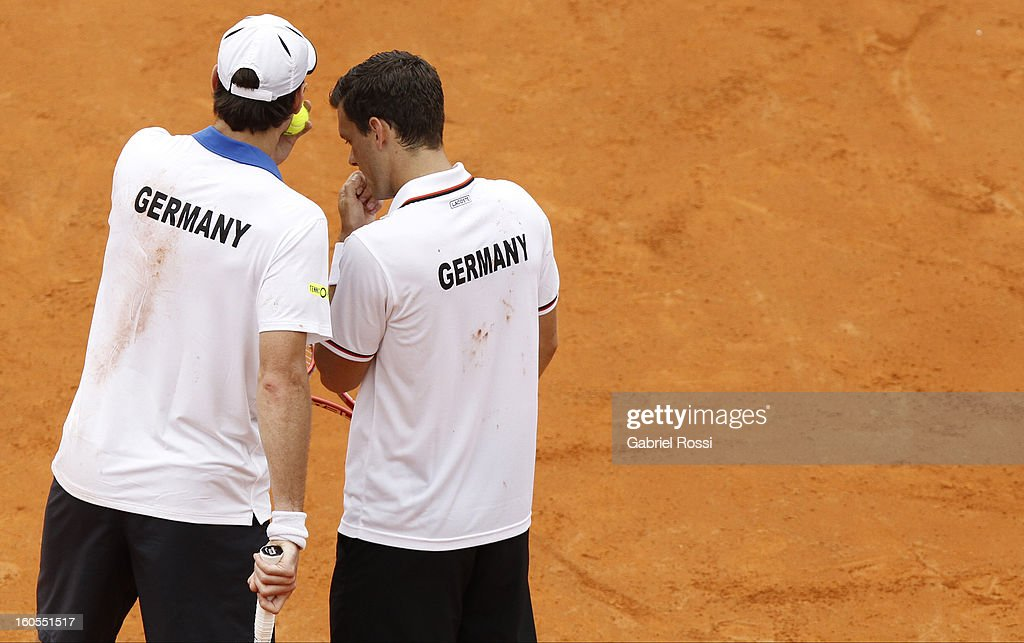 Christopher Kas and Tobias Kamke of Germany talk during the match against David Nalbandian and Horacio Zeballos of Argentina on the second day of...