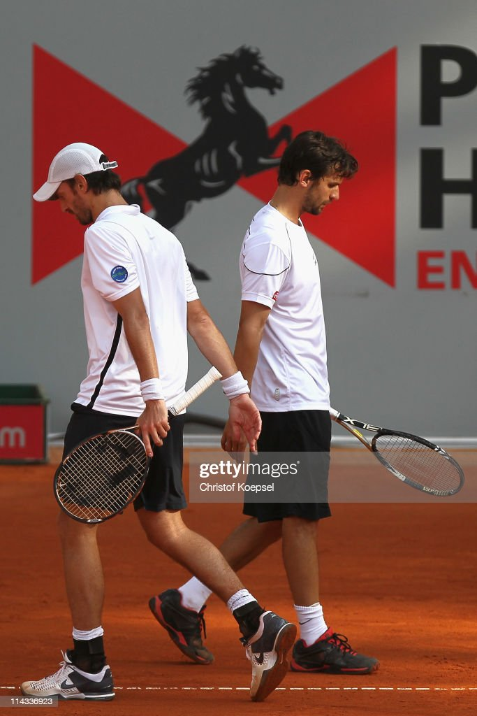 Christopher Kas of Germany and Philipp Petzschner of Germany look dejected during the match between Philipp Petzschner and Christopher Kas and Marcel Granollers and Marc Lopez of Spain in the blue group during day four of the Power Horse World Team Cup at the Rochusclub on May 18, 2011 in Duesseldorf, Germany. Philipp Petzschner and Christopher Kas of Germany lost 6-7 and 3-6 against Marcel Granollers and Marc Lopez of Spain and Germany lost 1-2 in the team against Spain.