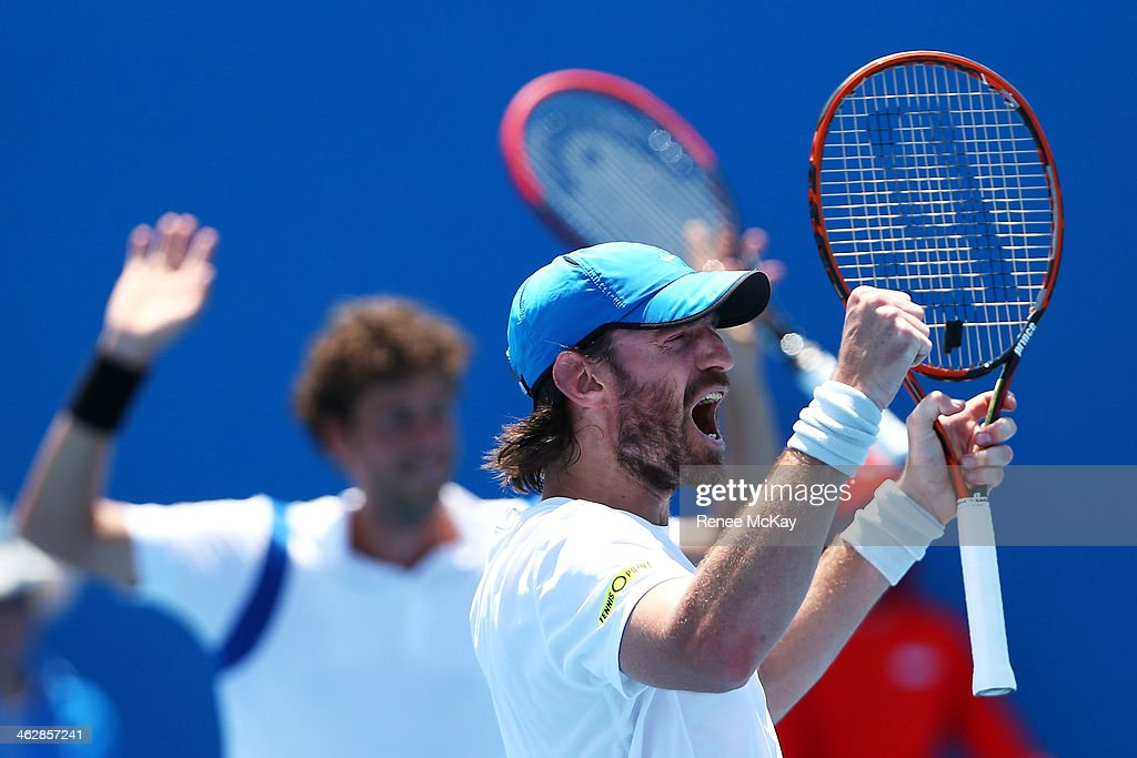 Christopher Kas of Germany and Robin Haase of the Netherlands celebrate winning a point in their first round doubles match against Nikolay Davydenko...
