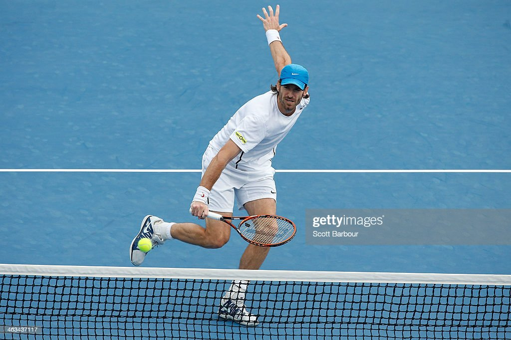 Christopher Kas of Germany plays a backhand in his second round doubles match with Robin Haase of the Netherlands against Bob Bryan of the United...