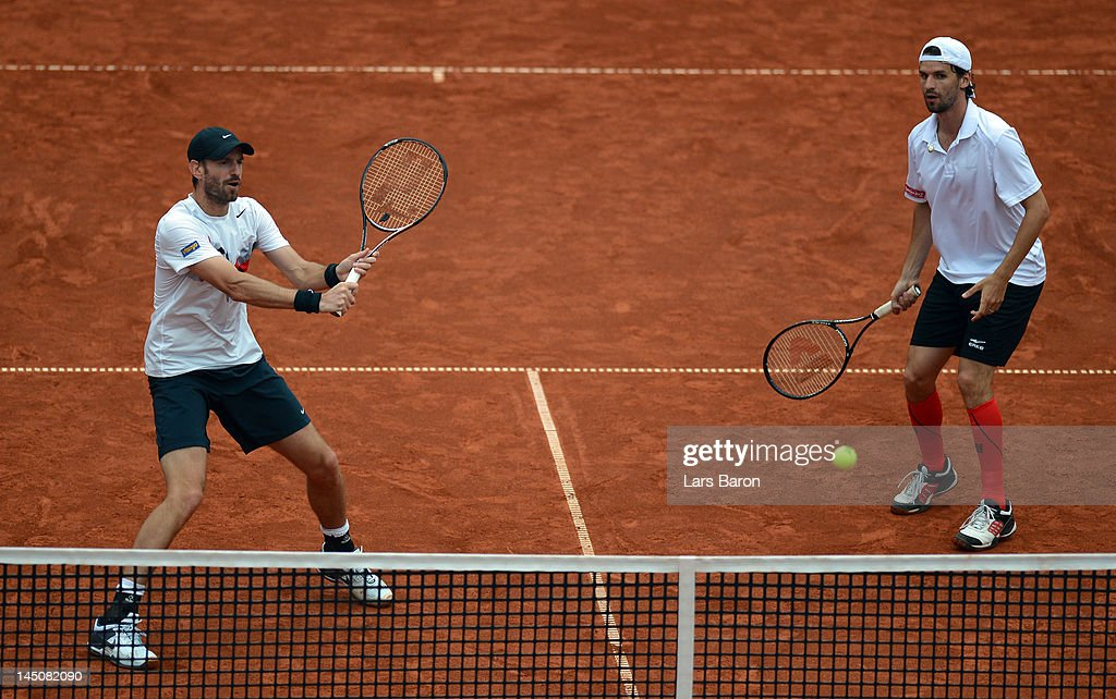 Christopher Kas of Germany plays a backhand next to team mate Philipp Petzschner during their match against Ivan Dodig and Lovro Zovko of Croatia...