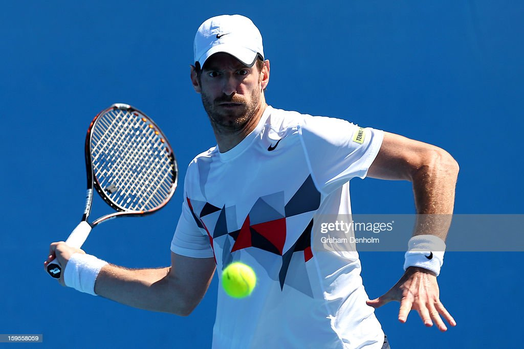 Christopher Kas of Germany plays a forehand in his first round doubles match with Dustin Brown of Germany against Marcel Granollers of Spain and Marc...