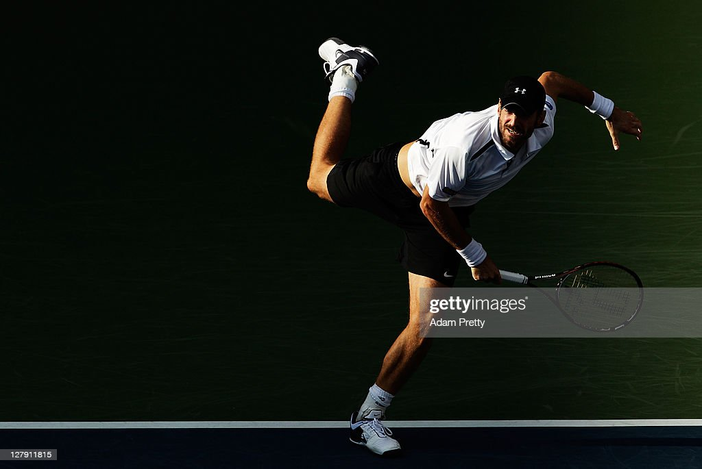 Christopher Kas of Germany serves during his first round doubles match against Tatsuma Ito and Kei Nishikori of Japan during day one of the Rakuten...