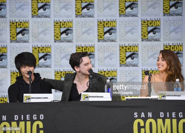 Christopher Larkin Richard Harmon and Lindsey Morgan speak onstage at ComicCon International 2017 'The 100' panel at San Diego Convention Center on...