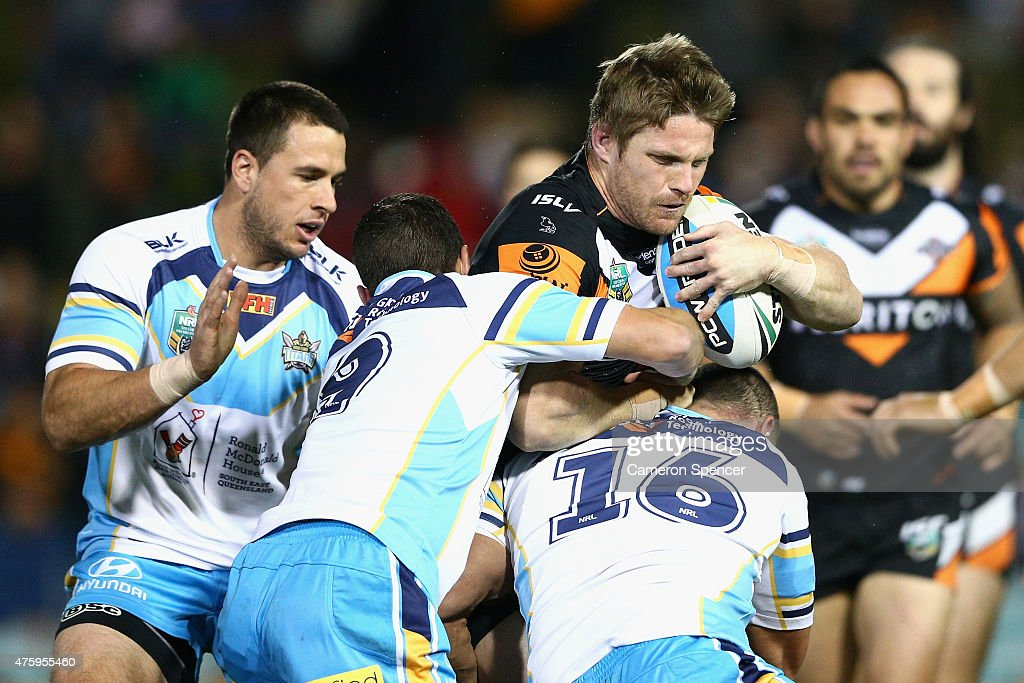 Christopher Lawrence of the Tigers is tackled during the round 13 NRL match between the Wests Tigers and the Gold Coast Titans at Leichhardt Oval on June 5, 2015 in Sydney, Australia.