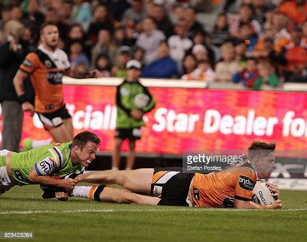 Christopher Lawrence of the Tigers scores a try during the round eight NRL match between the Canberra Raiders and the Wests Tigers at GIO Stadium on...