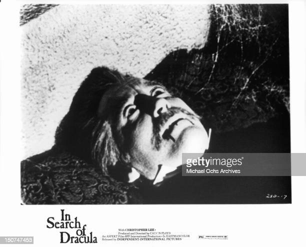 Christopher Lee as Dracula laying down with blood drooling out of his mouth in a scene from the film 'In Search Of Dracula' 1975