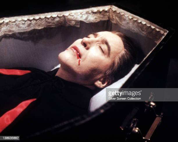 Christopher Lee British actor blood trickling from his mouth as lays in a coffin in a publicity still issued for the film 'Dracula' 1958 The Hammer...