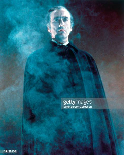 Christopher Lee British actor in costume and enveloped in smoke in an atmospheric publicity portrait issued for the film 'Dracula Has Risen from the...