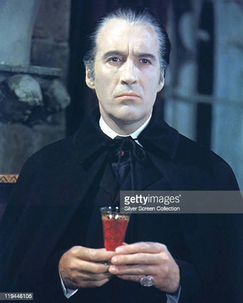 Christopher Lee British actor in costume and holding a glass of blood in a publicity portrait issued for the film 'Taste the Blood of Dracula' United...