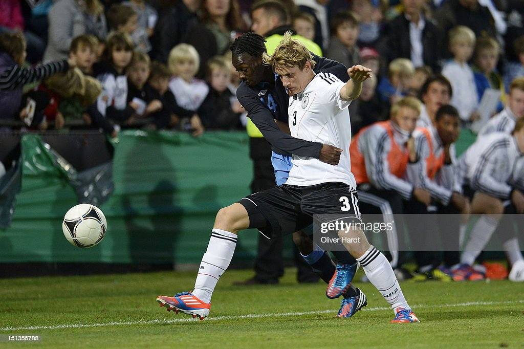 Christopher Lenz (R) of Germany and Blair Turgott (L) of England battle for the ball during the Under 19 international friendly match between Germany and England at Stadion an der Lohmuehle on September 6, 2012 in Luebeck, Germany.