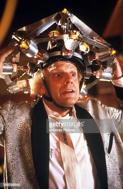 Christopher Lloyd wearing concoction on his head in a scene from the film 'Back To The Future' 1985