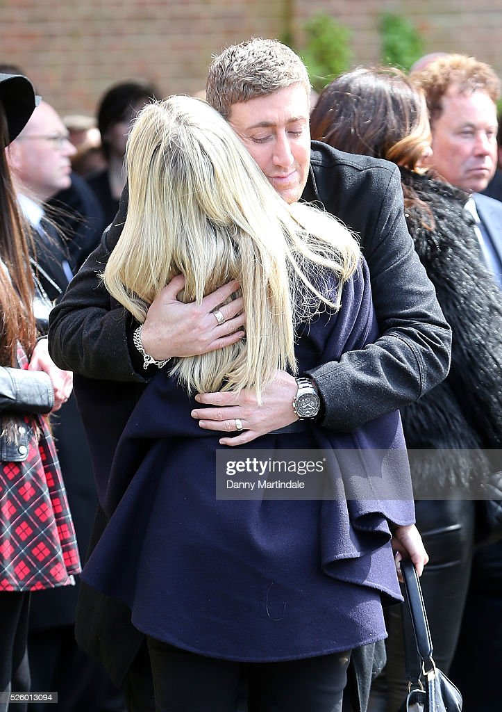 Christopher Maloney is comforted by a guest at the funeral of entertainer, producer and reality television star David Gest at Golders Green Crematorium on April 29, 2016 in London, England.