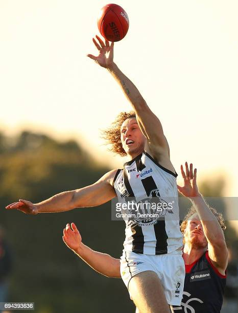 Christopher Mayne of Collingwood jumps for a mark during the round eight VFL match between Casey Demons and Collingwood Magpies at Casey Fields on...