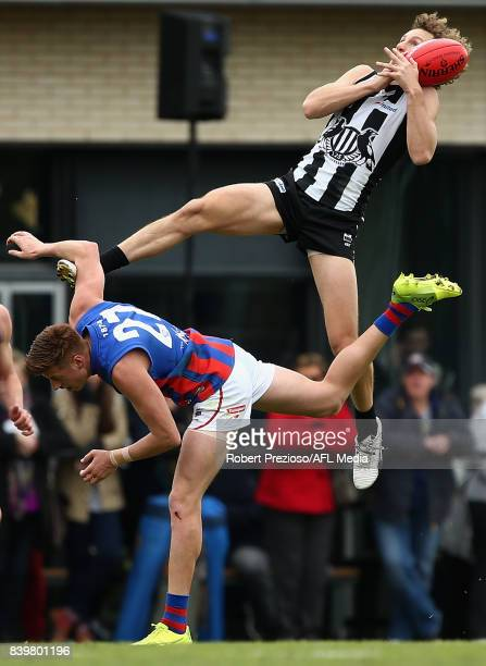 Christopher Mayne of Collingwood marks the ball during the round 19 VFL match between Collingwood and Port Melbourne at the Holden Centre on August...
