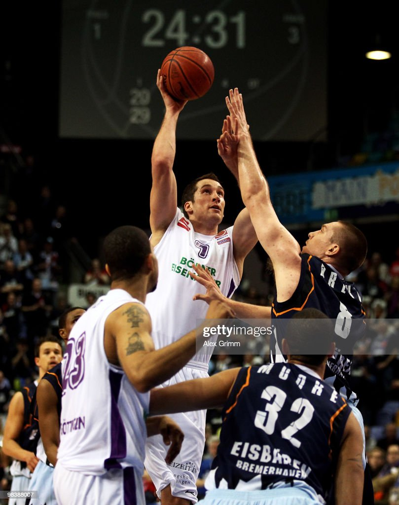 Christopher McNaughton of Goettingen tries to score against Andrew Drevo of Bremerhaven during the third place game between BG Goettingen and...