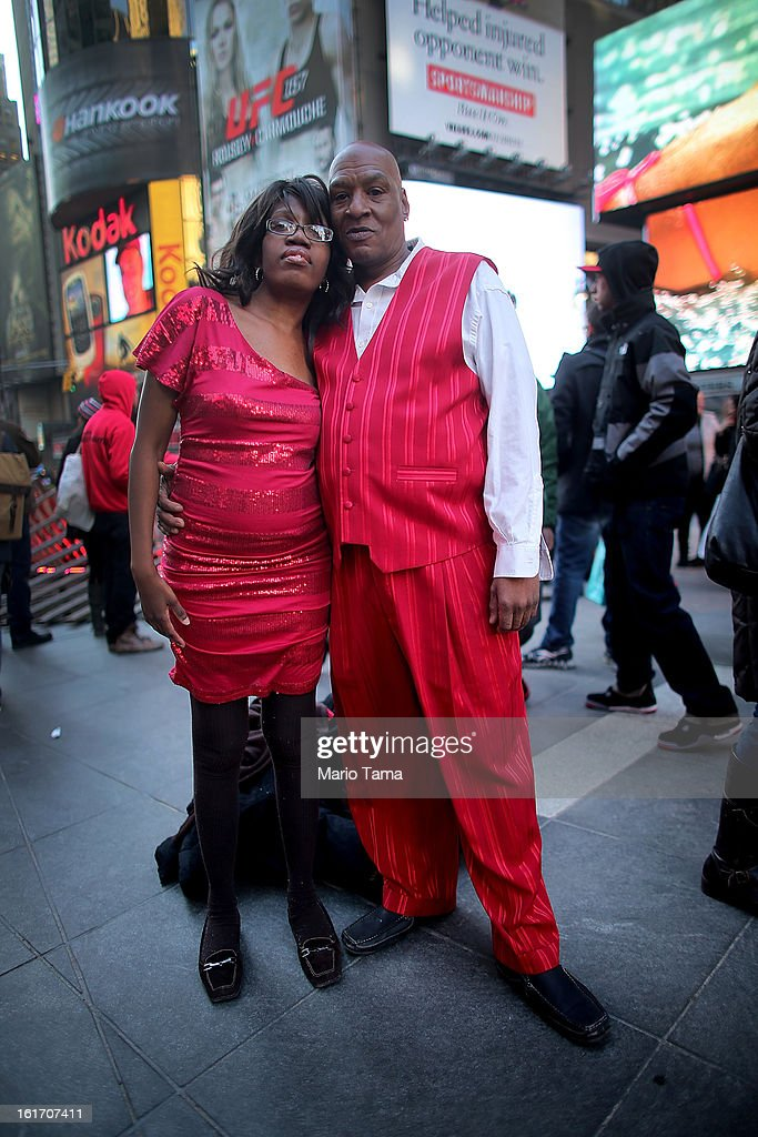 Christopher McVay and Tamesha Leach pose in Times Square on Valentine's Day on February 14, 2013 in New York City. The pair live outside of the city in Yonkers, New York, and came to the city to celebrate the holiday.