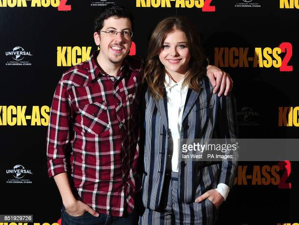 Christopher MintzPlasse and Chloe Grace Moretz during a photocall for the film Kick Ass 2 at Claridges Hotel in London
