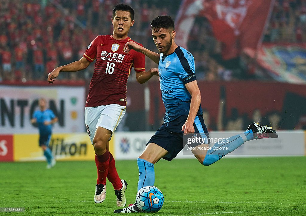 Christopher Naumoff of Sydney FC (R) being followed by Huang Bowen of Guangzhou Evergrande (L) during the AFC Asian Champions League match between Guangzhou Evergrande FC and Sydney FC at Tianhe Stadium on May 3, 2016 in Guangzhou, China.